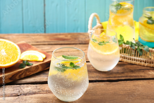 Delicious refreshing citrus drink on wooden table