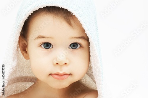Obraz na plátně Cute infant boy with beautiful eyes wrapped into hooded towel after a bathing
