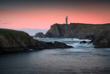 Valdoviño Cliffs And Meirás Or Punta Frouxeira Lighthouse At Sunset. Galicia, Spain