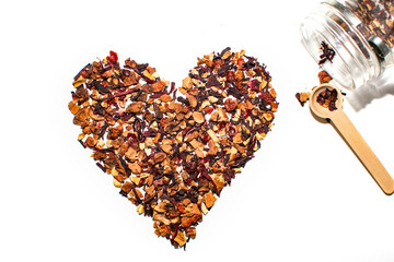Valentine day flatly. Heart made of orange tea leaves on white background. Top view. Autumn mood, love, tea time concept.