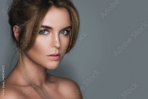 Fototapeta Young and stunning woman with a natural makeup
