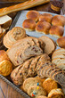 Bread. Bread, loafs, rolls, baguettes, bagels, slices of fresh homemade bread. Traditional classic bakery goods. Made from scratch in a bakery by a baker.