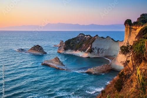Fototapeta Corfu, Greece. Cape Drastis cliffs at sunset.