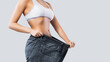 canvas print picture - Woman showing result after weight loss wearing on old jeans