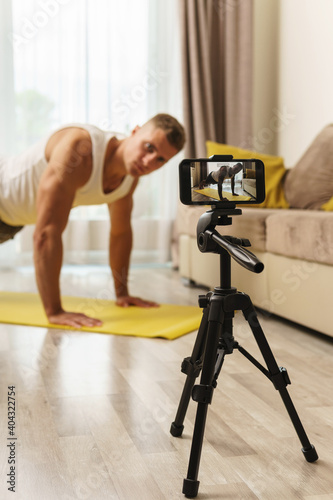 Fototapeta Fitness blogger streaming or recording video for his subscribers obraz