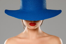 Portrait Of Stranger Girl With Red Lips Wearing Blue Hat