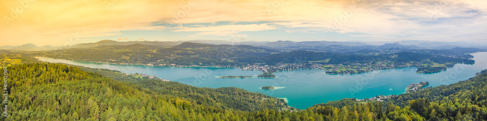 Fototapeta Aerial view of the alpine lake Worthersee, famous tourist attraction for many water activity in Klagenfurt, Carinthia, Austria