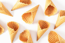 Empty Ice Cream Waffle Cone On White Background. Flat Lay, Top View, Copy Space