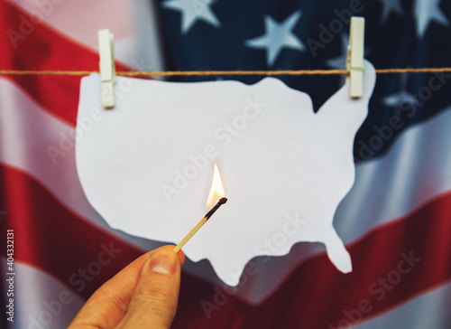 Obraz map of america USA burning match - as a symbol of  incitement to crisis and chaos of division in country. - fototapety do salonu