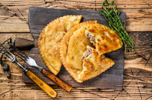 Chilean Fried Empanadas Filled With Minced Beef Meat Served On A Wooden Cutting Board. Wooden Background. Top View