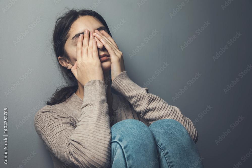 Fototapeta sad woman sitting in ground