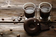 Tasty Chocolate Donuts And Coffee On Wooden Background