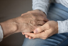 Crop Close Up Of Elderly Father And Adult Son Hold Touch Hands Showing Love And Care In Family Relations. Loving Man Support Comfort Stressed Unhappy Mature Dad, Feel Grateful And Thankful.