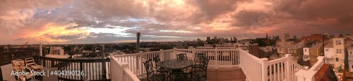 Fotografie, Obraz Panoramic View Of City Against Sky During Sunset