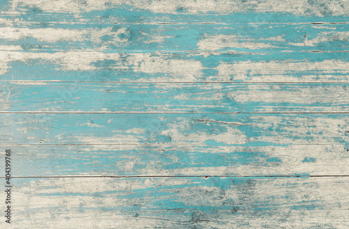 Obraz Weathered blue painted wooden wall. Vintage blue wood plank background. Old blue wooden wall coming from beach. - fototapety do salonu
