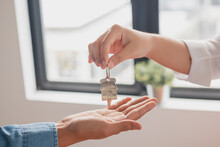 Close Up Hand Of Home, Apartment Agent, Realtor Was Holding The Key To The New Landlord, Tenant Or Rental.After The Banker Has Approved And Signed The Purchase Agreement Successfully.Property Concept.