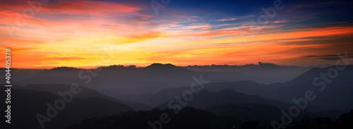 Obraz Scenic View Of Silhouette Mountains Against Orange Sky - fototapety do salonu