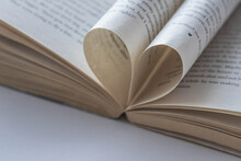 A Book Page With A Heart Shape On An Open Book. Valentine's Day. Love.