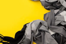 Top View Flat Lay Gray Trendy Scarf On Yellow Background