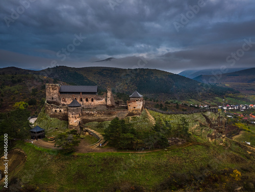 Boldogko, Hungary - Aerial panoramic view of Boldogko Castle (Boldogko vara/Boldogkovaralja) at autumn season with Zemplen Mountains at the background at sunset with blue sky and clouds