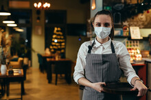 Woman Waitress Posing In Cafeteria With Protective Face Mask