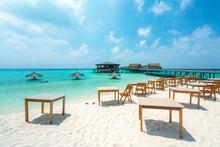 Empty Tables At Beach Against Sky