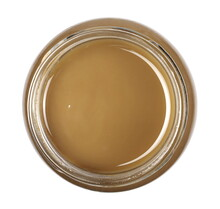 Integral Sesame Butter, Unpeeled Seeds, Tahini Paste In Glass Jar Isolated On White Background, Top View