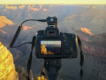 A Dslr Camera In Use To Take Pictures Of A Sunrise At Grand Canyon Mather Point On A Sunny Morning