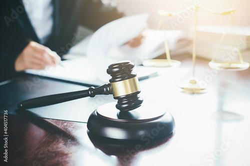 Obraz na plátně Midsection Of Lawyer By Gavel At Office