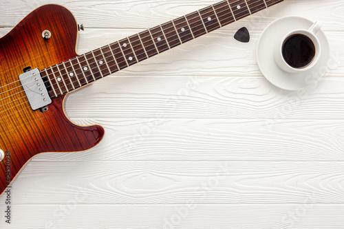 Obraz na plátně Desk of musician for songwriter work set with headphones and guitar