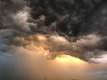 Low Angle View Of Storm Clouds In Sky During Sunset