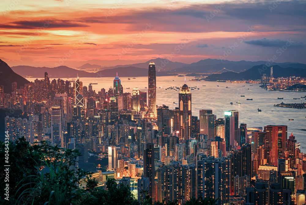 Fototapeta Hong Kong city on dramatic sky at sunset view from mountain.
