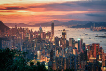 Hong Kong City On Dramatic Sky At Sunset View From Mountain.