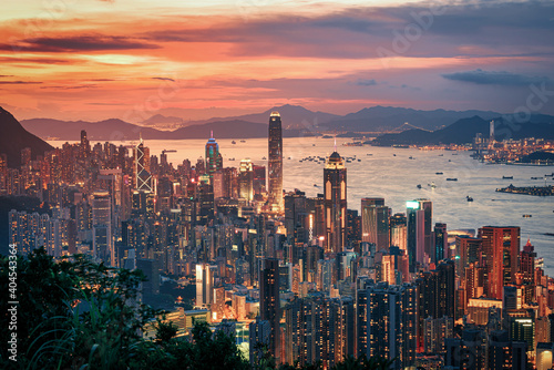 Obraz Hong Kong city on dramatic sky at sunset view from mountain. - fototapety do salonu