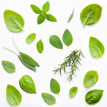 Directly Above Shot Of Various Herbs Over White Background
