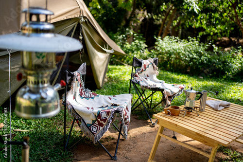 Tela Camping tent and equipment accessory in the forest at Thailand.