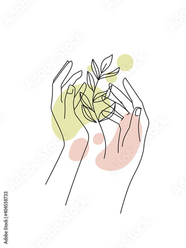 Female hands with branch leaf and abstract background Fotobehang