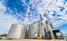 Industrial Agriculture Elevators With Harvested Grain. Grain Cooperative. Closeup.
