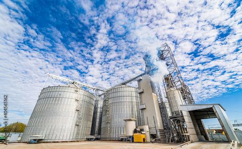 Obraz Industrial agriculture elevators with harvested grain. Grain cooperative. Closeup. - fototapety do salonu
