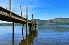 Wooden Bridge Over River Against Sky