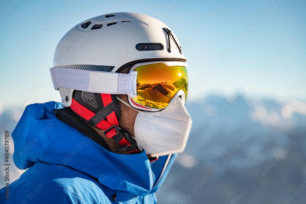 Obraz Portrait of a male skier wearing a FFP2 mask fototapeta, plakat