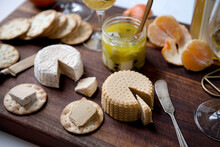 Plant Based, Dairy Free Cheeses On Wooden Board
