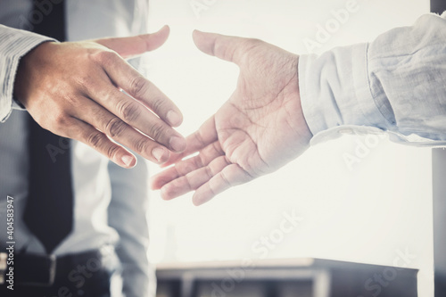 Canvas Print Midsection Of Business Colleagues Shaking Hands While Standing In Office
