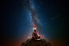 Buddhist Monk Looking At The Universe