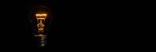 Incandescent Light Bulb On Black Background