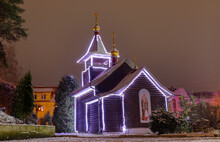 Small Orthodox Wooden Church With Night Lighting