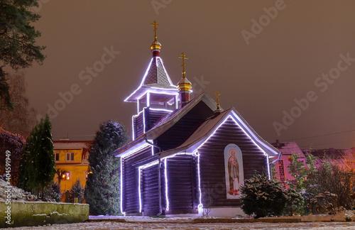 Obraz na plátně Small orthodox wooden church with night lighting