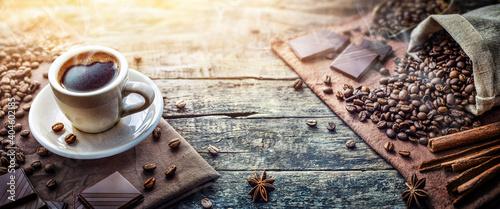Fototapeta A cup of aromatic morning coffee, zeena coffee, cinnamon, chocolate on the table. Nice background for coffee shop, restaurant menu. obraz