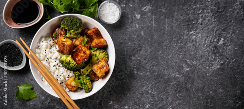 Canvas Print Fried tofu bowl with broccoli and rice. Vegan food