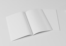 Blank Magazine Open In Half With Another Magazine Underneath Showing The Cover. On A White Background. 3D Illustration